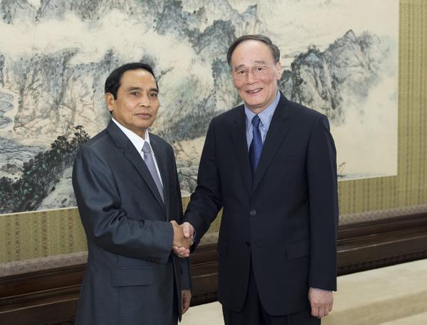 王岐山会见老挝人民革命党代表团